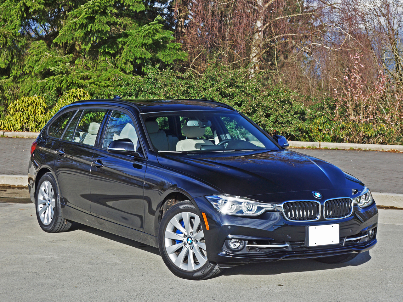 2016 BMW 328i xDrive Touring Road Test Review | CarCostCanada™